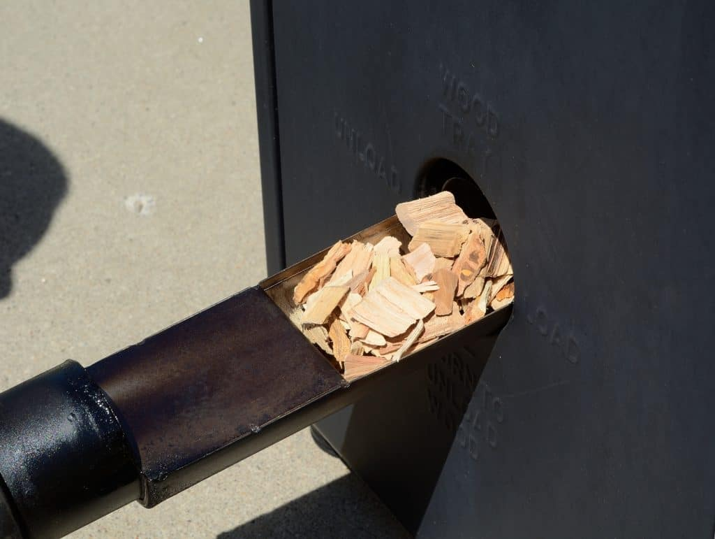 Putting Wood Chips in a Smoker