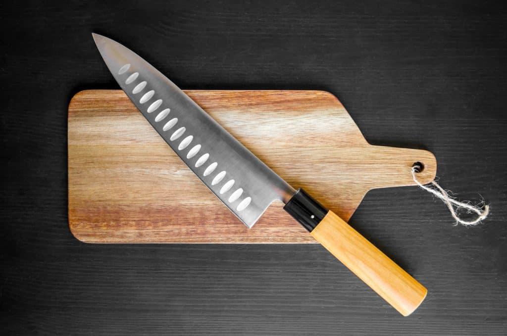 gyuto knife on a cutting board